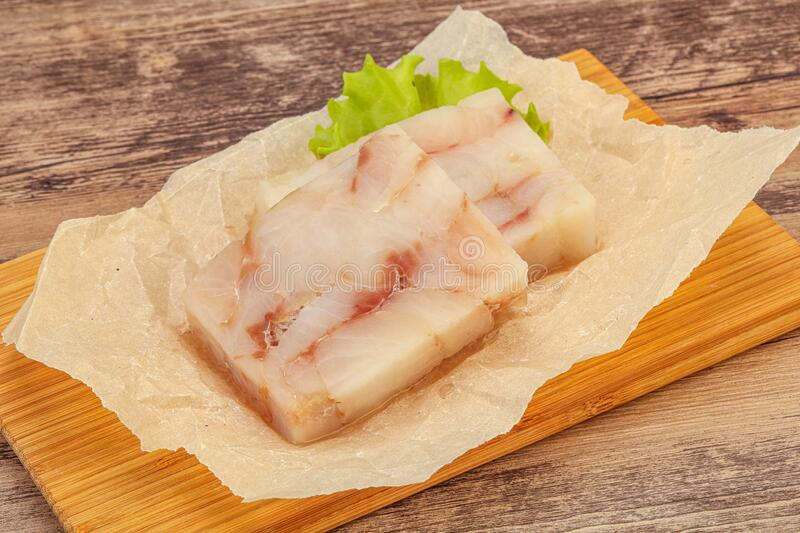 Raw pollock fish fillet for cooking. Raw dietary pollock fish fillet for cooking stock photos