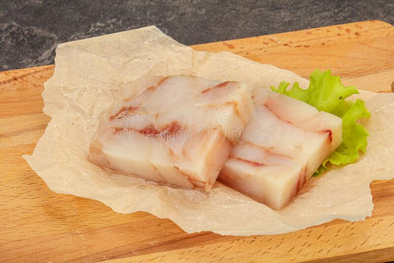 Raw pollock fish fillet for cooking. Raw dietary pollock fish fillet for cooking stock image