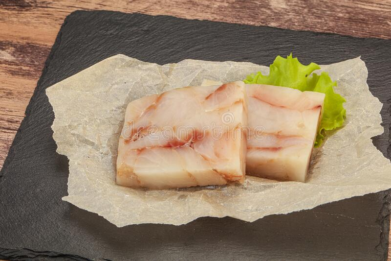 Raw pollock fish fillet for cooking. Raw dietary pollock fish fillet for cooking stock photo