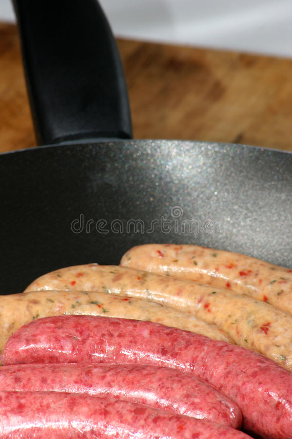 Raw pork and beef sausages royalty free stock photo