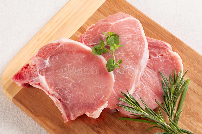 Download Raw pork chops stock photo. Image of juicy, herb, board - 19767718
