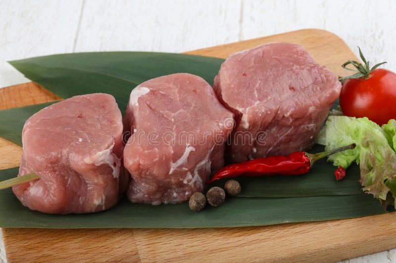 Raw pork fillet mignon. Ready for cooking royalty free stock photos