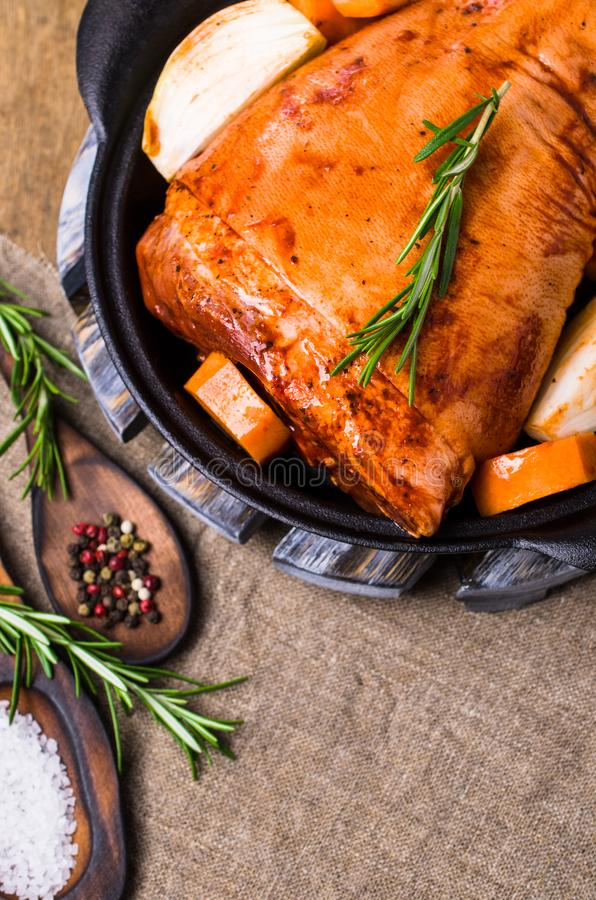 Raw pork knuckle in marinade. With spices and vegetables. Selective focus stock photography