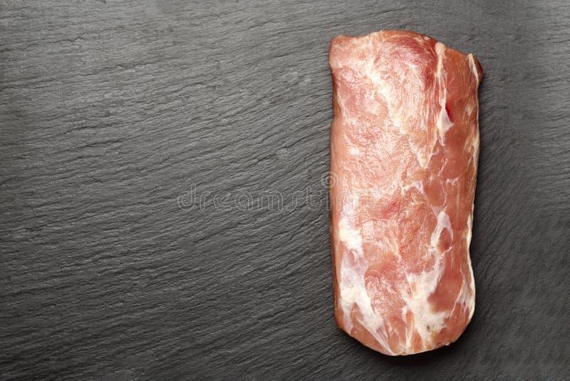 Pork meat on black background royalty free stock photo