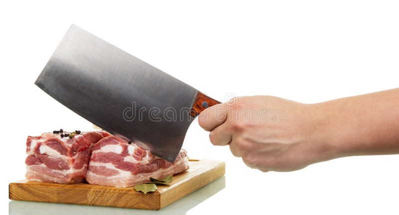 Raw pork meat, cutting board, human hand holding cutter isolated. royalty free stock images