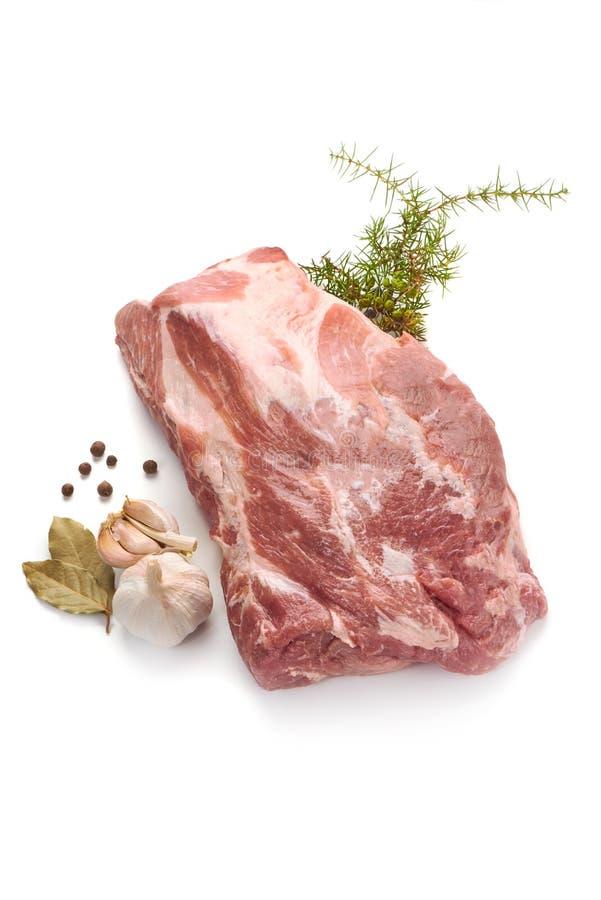 Raw pork neck boneless, close-up, isolated on white background.  royalty free stock images