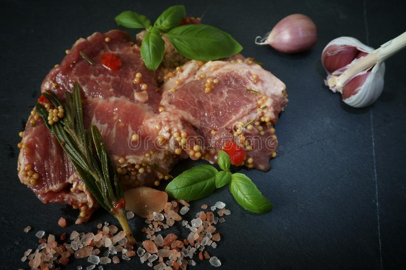 Raw pork neck meat with spices ready for barbeque royalty free stock photos