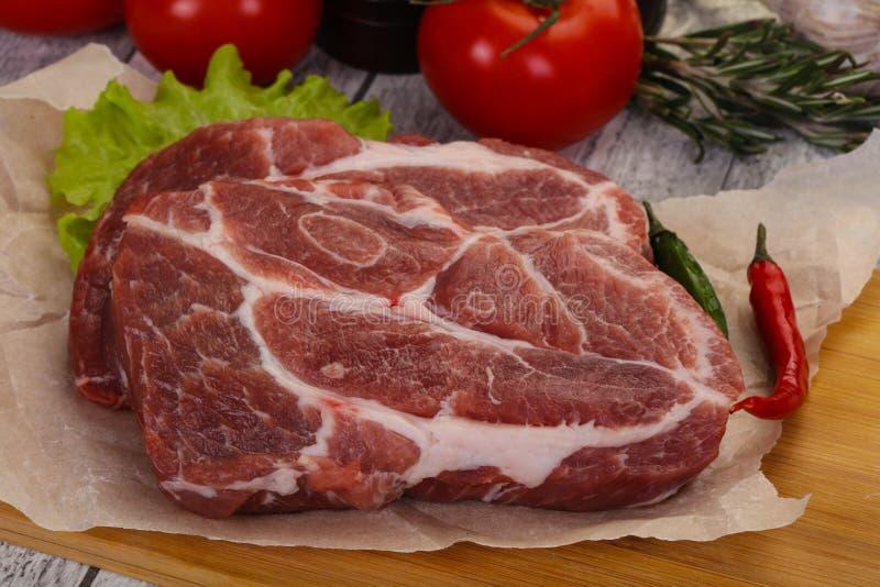 Raw pork neck steak stock images