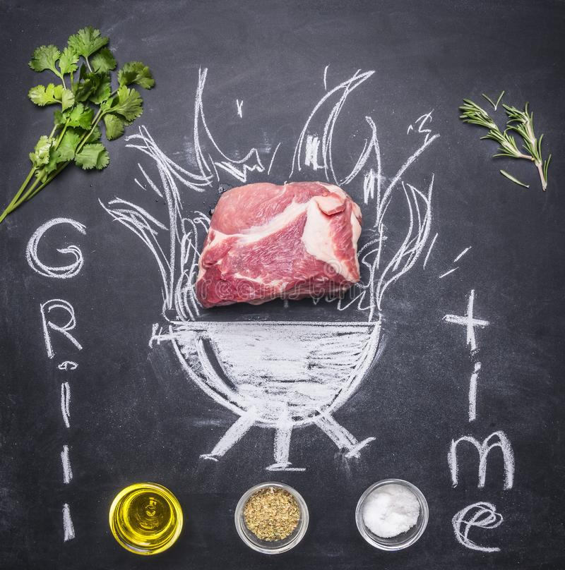 Raw pork steak on a chalkboard painted with a burning grill with herbs and spices, oil and inscription royalty free stock photo