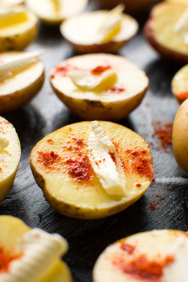 Raw potato with butter and red pepper. Raw potato with butter and ground red pepper stock photo