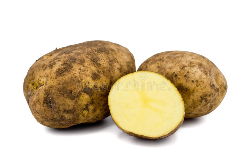 Raw Potatoes. Three raw potatoes on the white background royalty free stock images