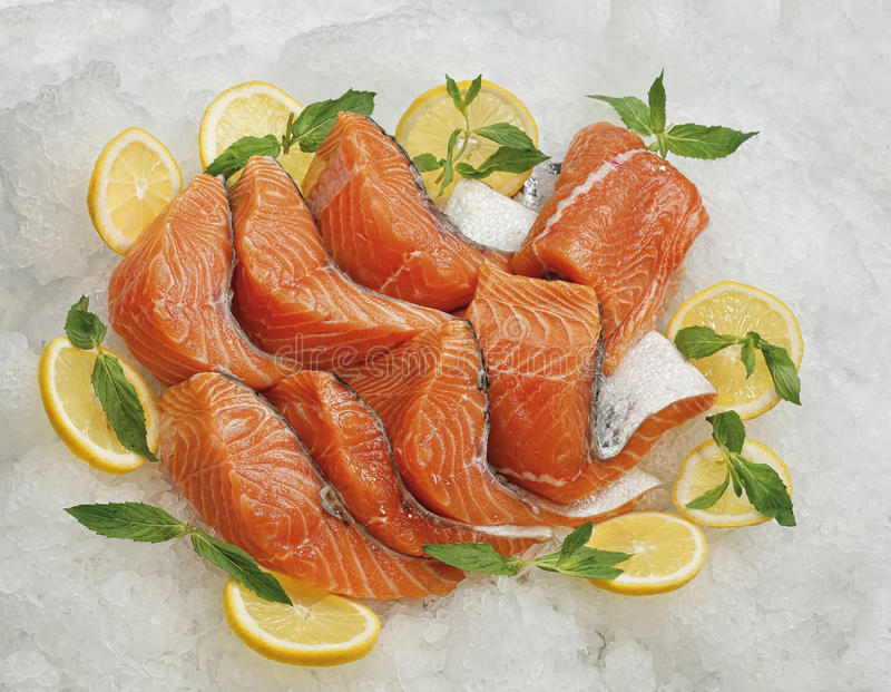 Raw red fish is sliced, ready for sale in a supermarket royalty free stock photography