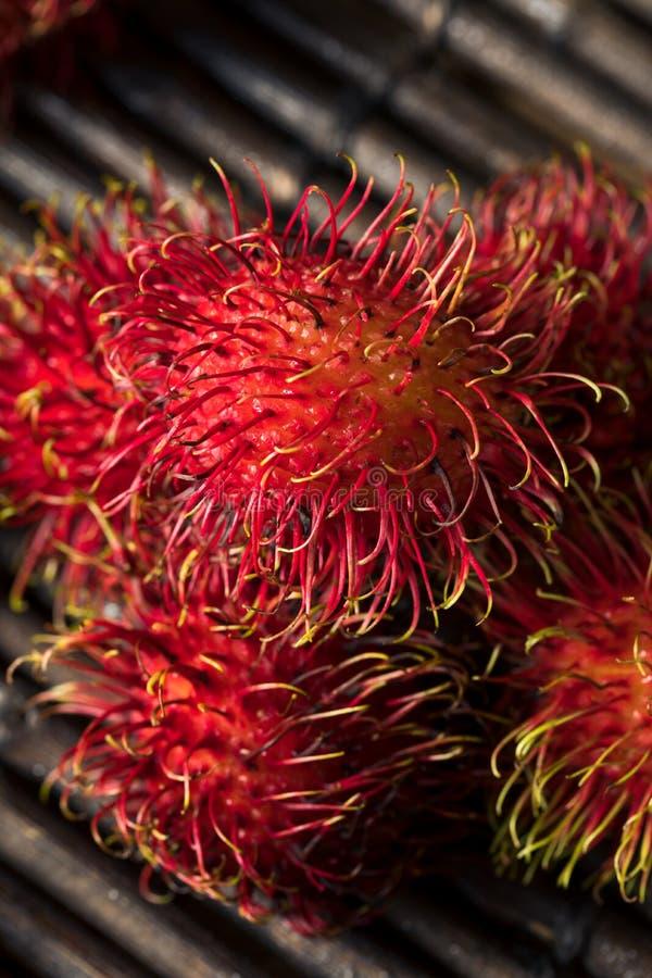 Raw Red Organic Rambutan Fruit. Ready to Eat stock photos