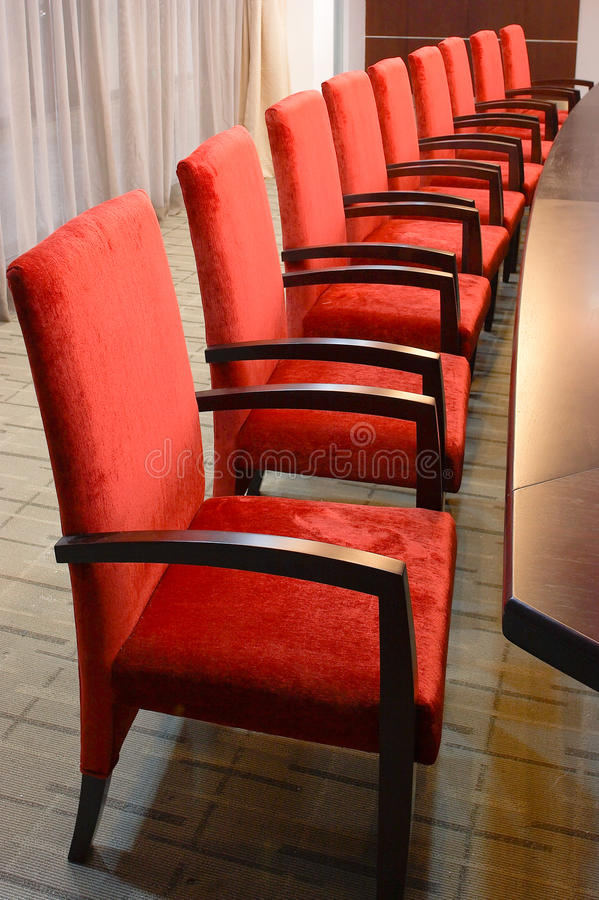 Raw of red soft chairs stock photo