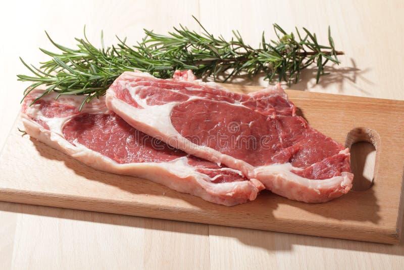 Raw rib steaks royalty free stock photography