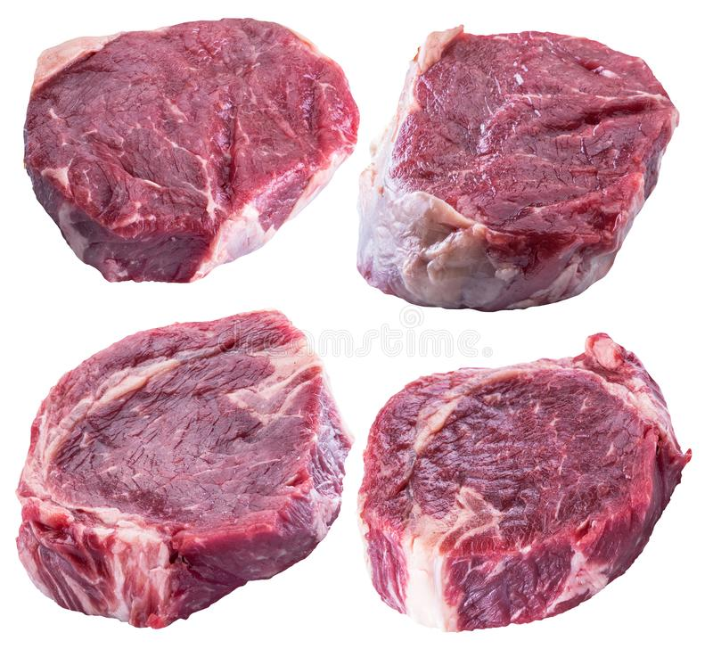 Raw Ribeye steaks or beef steak on white background. Clipping pa. Raw Ribeye steaks or beef steak set on white background. File contains clipping path royalty free stock photography