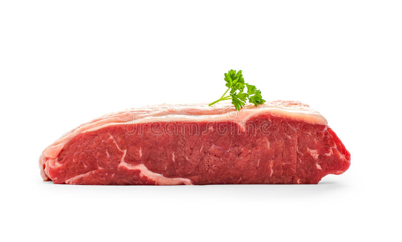 Raw rump steak with parsley twig. Isolated on white stock photo