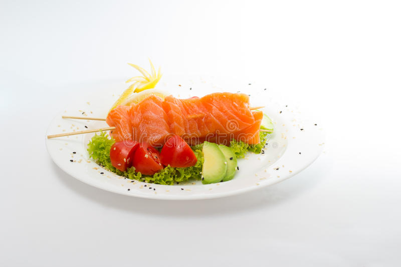 Raw salmon fillet with vegetables. And chopsticks royalty free stock photos