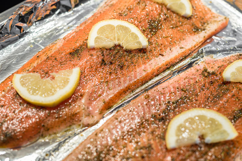 Raw salmon fish fillet in foil royalty free stock photo