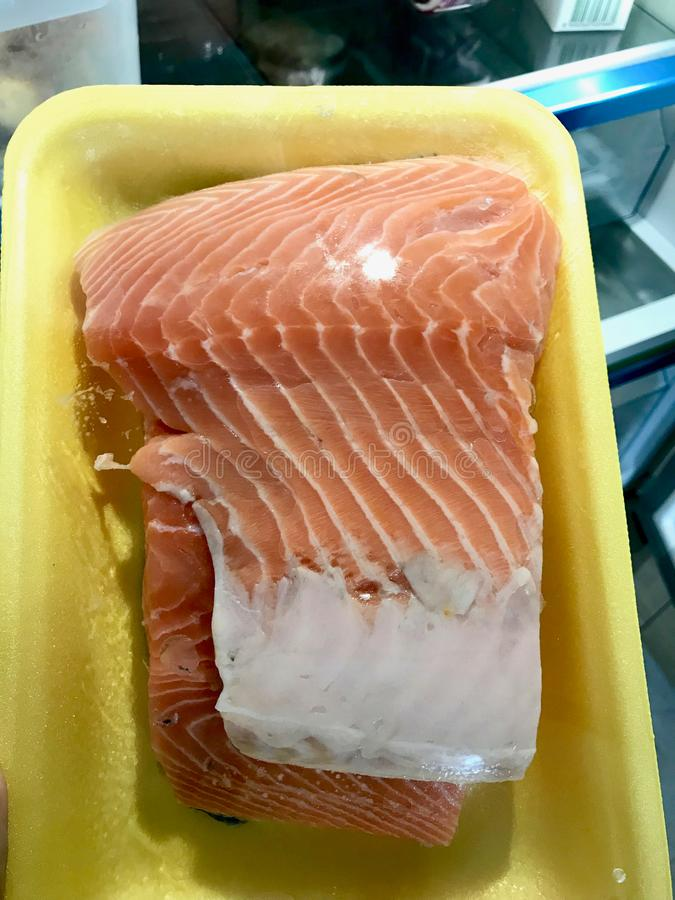 Raw Salmon Fish Fillets in Plastic Box / Package or Container for Sale. To Eat stock photography
