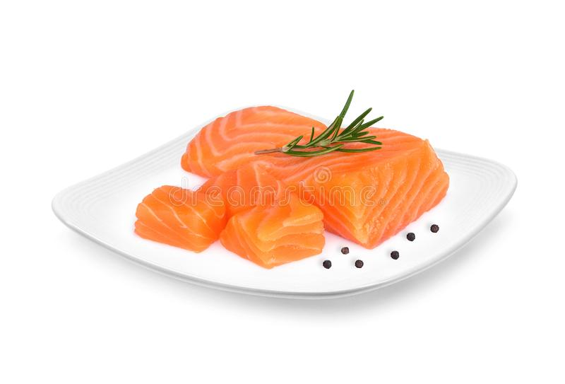 Raw salmon piece with rosemary the white plate isolated on white royalty free stock photography