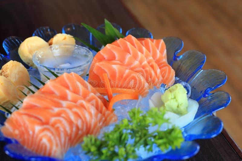 Raw salmon slice or salmon sashimi fresh serve on ice japanese download raw salmon slice or salmon sashimi fresh serve on ice japanese food recipe forumfinder Image collections