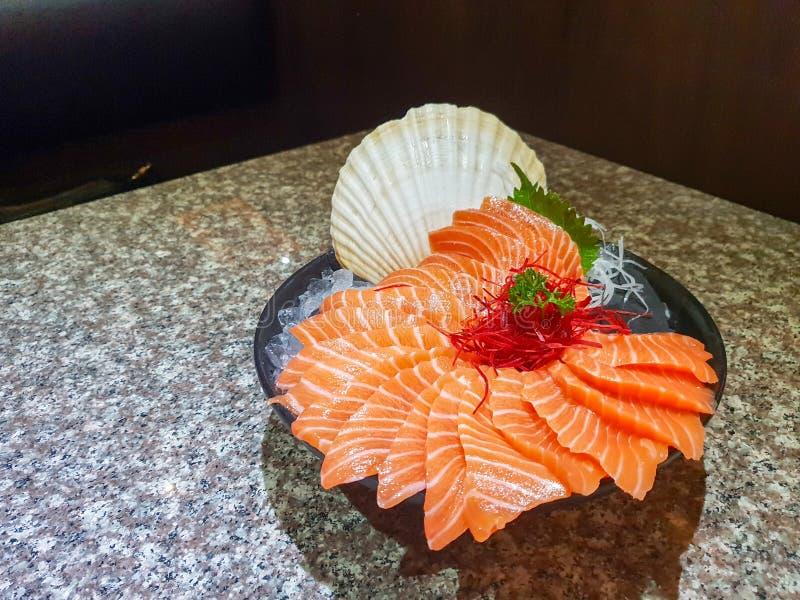 Raw salmon slice or salmon sashimi stock image