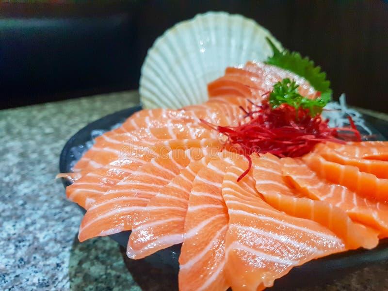 Raw salmon slice or salmon sashimi stock images