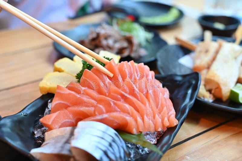 Raw salmon slice or salmon sashimi ok plate in Japanese style royalty free stock photography