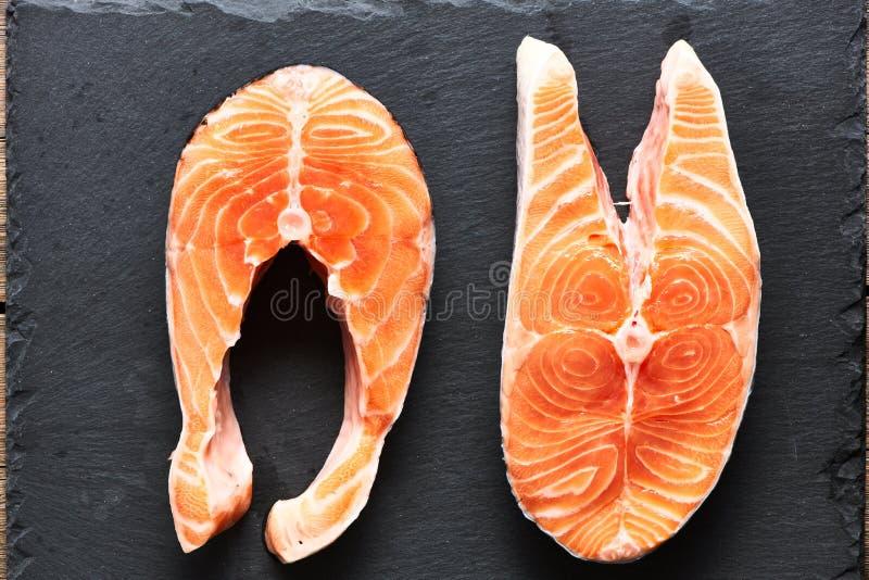 Raw salmon steaks stock photos