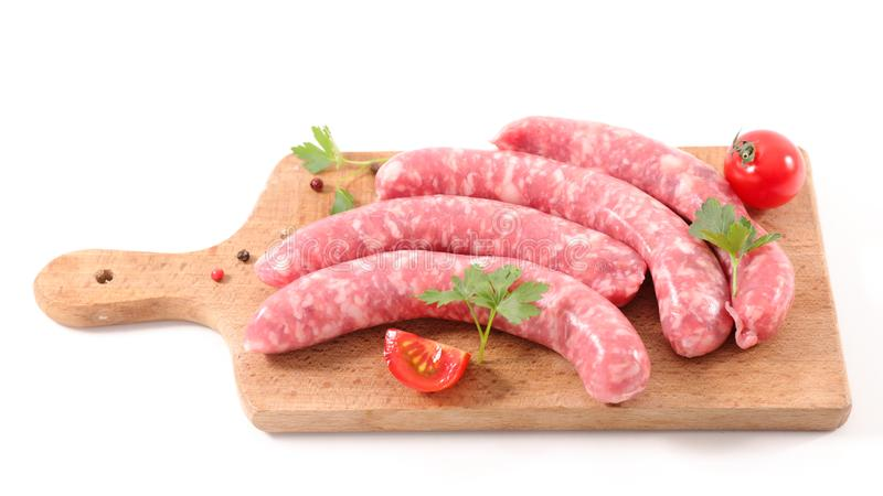 Raw sausage isolated on white stock image