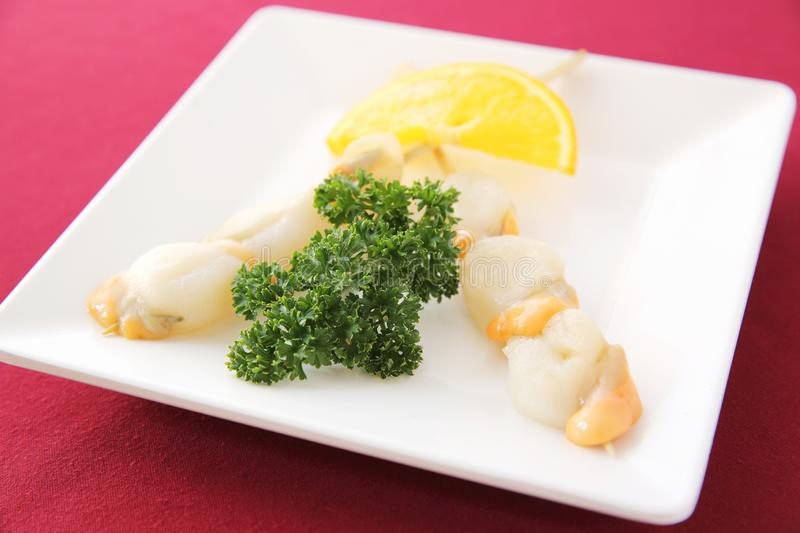 Raw scallop set. On a plate stock photo