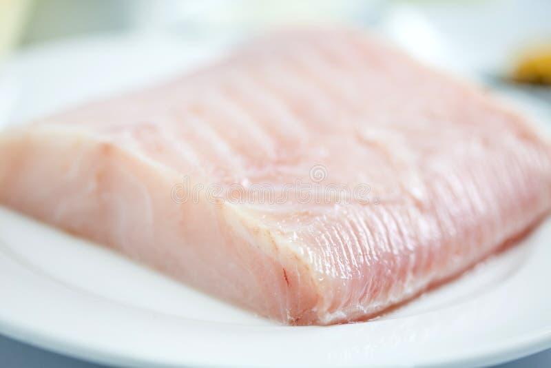 Raw sea bass fillet. Fish fillet preparation : Raw sea bass fillet stock image