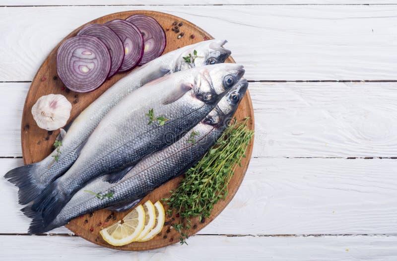 Raw sea bass fish. Cooking fresh seabass stock photo