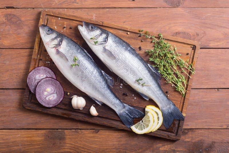 Raw sea bass fish. Cooking fresh seabass royalty free stock image