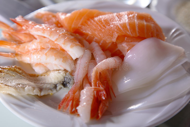 Raw Seafood. A plate of raw seafood, sliced and ready for use in sushi-making stock image