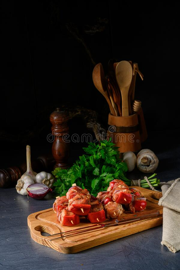 A raw shish kebab with various vegetables. Raw shish kebab with various vegetables stock photos