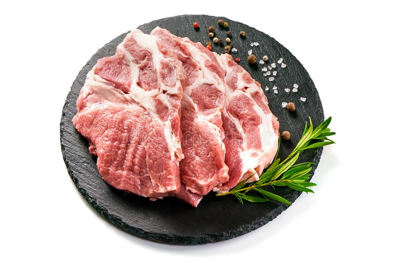 Raw sliced pork meat on stone board, isolated on white background royalty free stock images