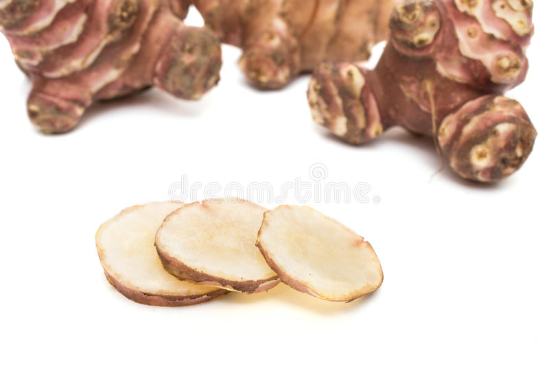 Raw slices of topinambour. White isolated raw slices of topinambour royalty free stock photos
