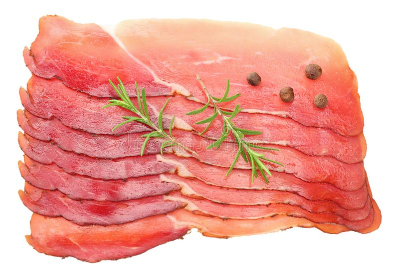 Raw smoked black forest ham with rosemary and peppercorns isolated on white background. top view stock photo