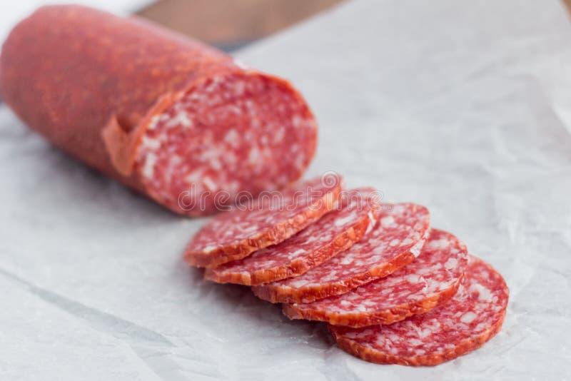 Raw smoked sausage, salami cut into pieces stock image