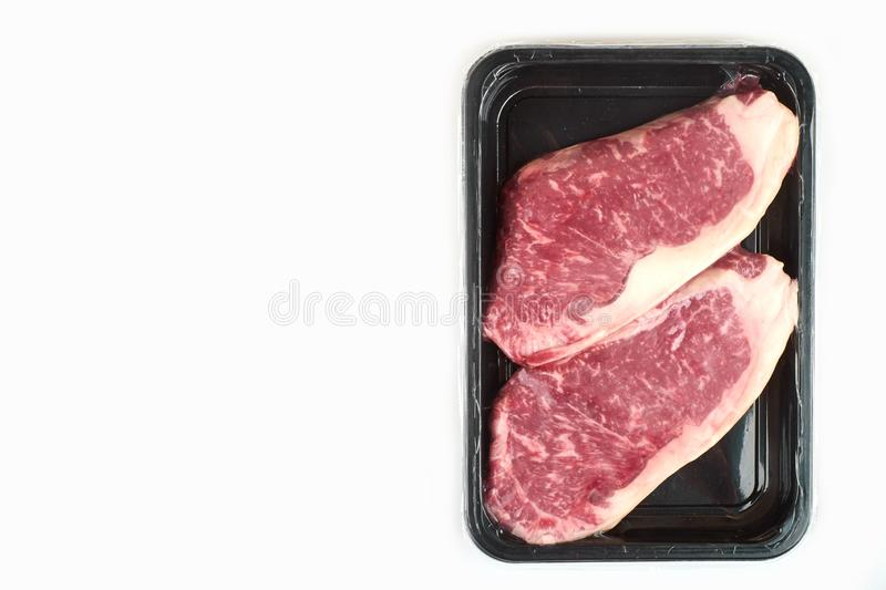 Raw steak in an airtight vacuum package on a white background. royalty free stock photo
