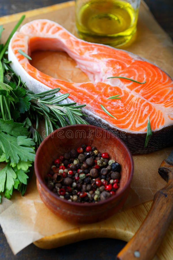 Raw Steak Salmon, greens and spice on a cutting board stock photos