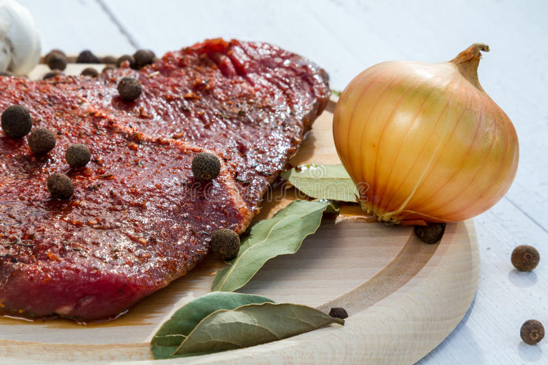 Raw steak spiced ready for roasting royalty free stock photography