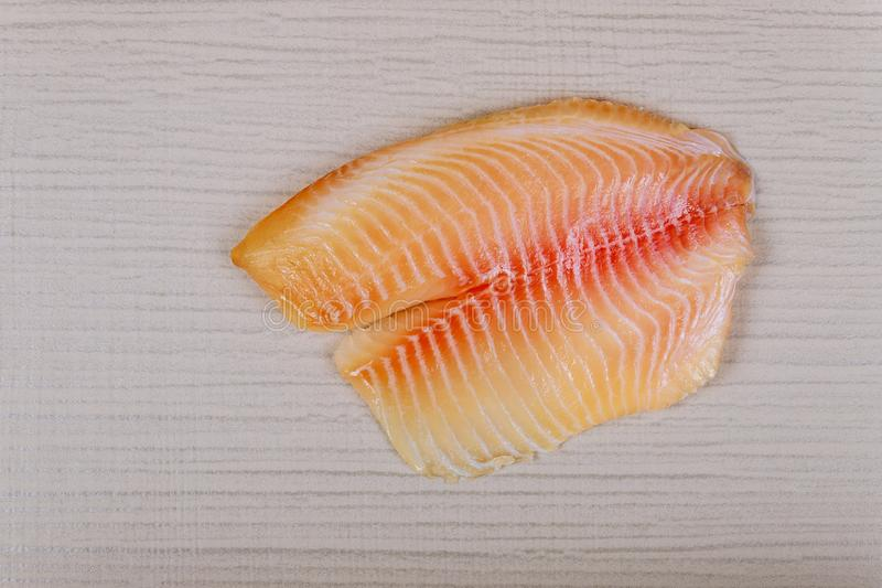 Raw tilapia fish fillet with ready for cooking royalty free stock photography