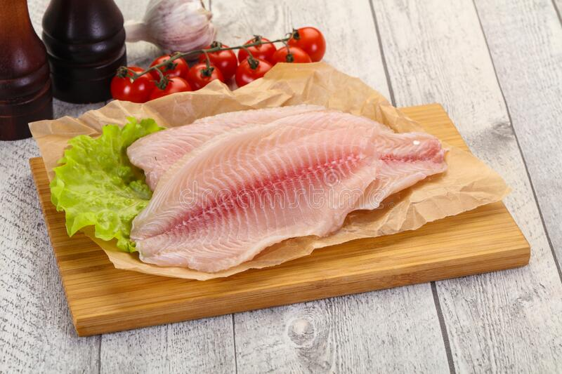 Raw tilapia fish. Ready for cooking royalty free stock image