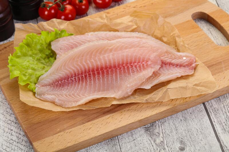 Raw tilapia fish. Ready for cooking royalty free stock images