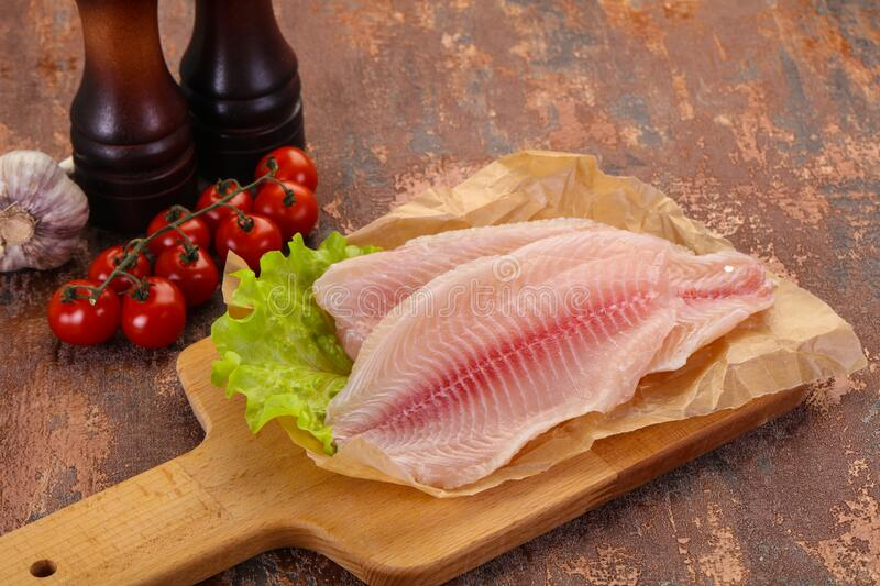 Raw tilapia fish. Ready for cooking stock photos
