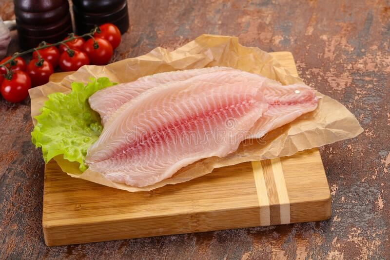 Raw tilapia fish. Ready for cooking royalty free stock photos