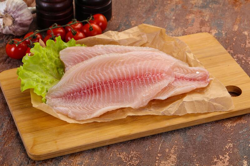 Raw tilapia fish. Ready for cooking royalty free stock photography